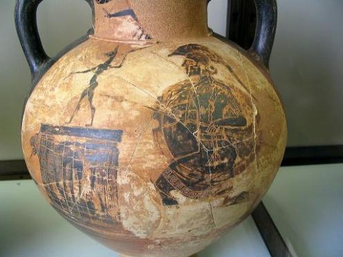 Black figure pottery depictinh a hoplite probably a mercenary making an offering to an Egyptian god. Vatican Museum.